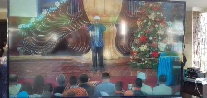 Adzam, Oleh Bapak Samad Tatuhey, Tokoh Agama Muslim Negeri Tial.