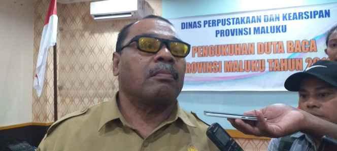 Drs. Mustafa Sangadji,MM Kepala Dinas Perpustakaan dan Kearsipan Provinsi Maluku.